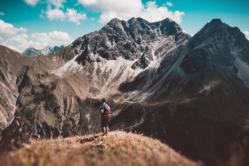 Hiker looking at beautiful steep mountain