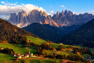 Wall Mural - Santa Maddalena village with magical Dolomites mountains in background, Val di Funes valley, Trentino Alto Adige region, Italy, Europe. Sunset view of dramatic Italian Dolomites landscape.