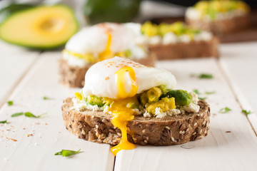 Breakfast sandwich with avocado and egg poached
