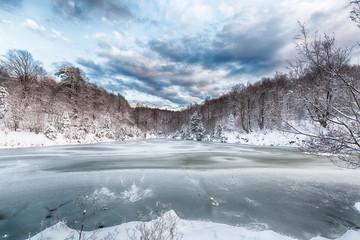 Frozen lake. Winter landscape.