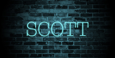 first name Scott in blue neon on brick wall