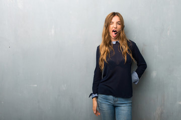 Telemarketer woman showing tongue at the camera having funny look