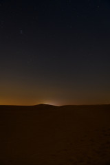 Night sky with stars above arabian desert