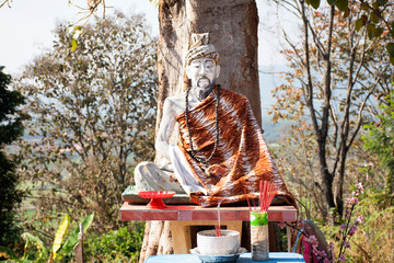 Hermit statue images at outdoor in Wat Phrachao Thanchai and Phra That San Kwang temple at Chiangrai, Thailand
