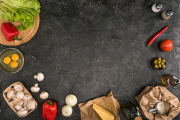 top view of pizza ingredients with copy space on grey background
