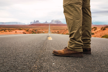 USA, Utah, Man standing on road to Monument Valley
