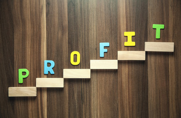Wall Mural - Colorful word Profit with wooden blocks.