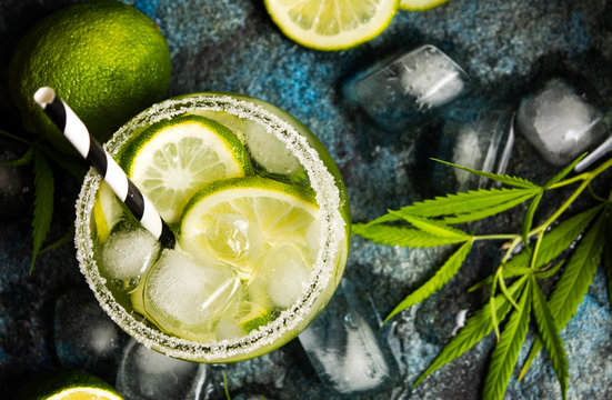Lime cocktails with marijuana on stone table