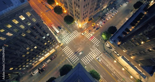 Fotobehang Night traffic on street intersection in downtown Los Angeles. View from above. Timelapse.
