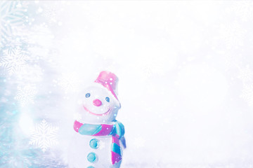 A miniature  Snowman on Christmas background.Xmas greeting card