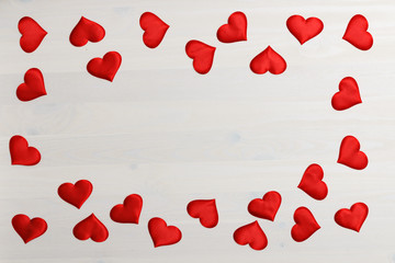 Closeup of red heart on a white wooden background with space for copy. Valentine's day celebration concept