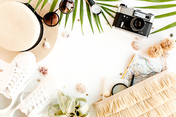 Top view on traveler accessories on white background. Essential vacation items, Travel concept background. Flat lay.