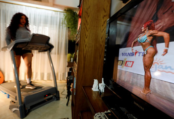 Dina Abdel-Maksoud, a 21-year-old Egyptian bodybuilder champion, uses treadmill at her home in Port Said