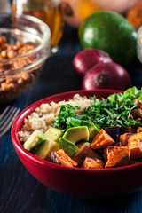 Colorful buddha bowl with quinoa and roasted and fresh vegetables