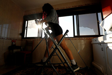 Dina Abdel-Maksoud, a 21-year-old Egyptian bodybuilder champion, exercises at her home in Port Said