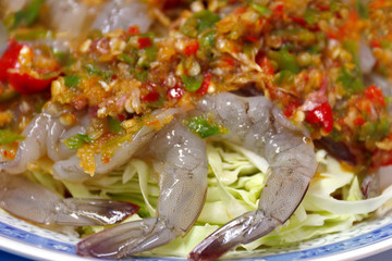 Shrimp in fish sauce Spicy hot, Shrimp in fish sauce Topped with chili peppers, Shrimp sea foods menu in chili sauce spicy close up (street food of thai)