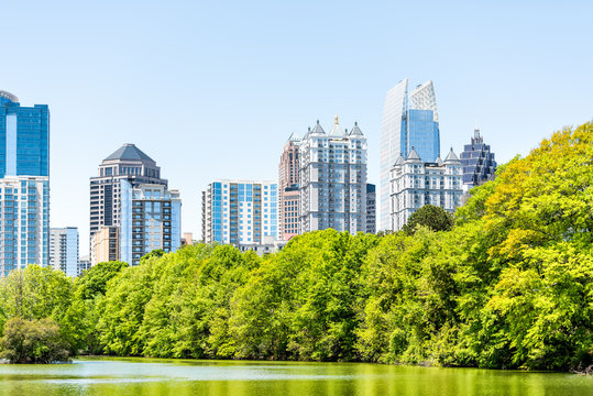 Atlanta, USA Cityscape, skyline view in Piedmont Park in Georgia downtown, green trees, scenic urban city town skyscrapers
