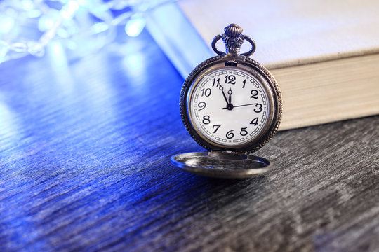 Vintage pocket watch with book