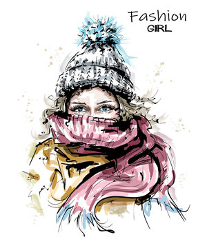 Hand drawn beautiful young woman in knit cap. Stylish winter look. Fashion woman with scarf. Sketch.
