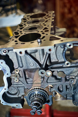 Automotive four-cylinder engine water cooling during repair.