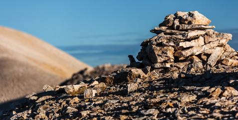 Pile of rocks on the top of Focalone mount, in the background the slope of Acquaviva mount, amphitheater of the Murelle, Majella national park, Abruzzo, Italy, Europe