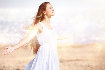 Happy woman with arms open on natural background