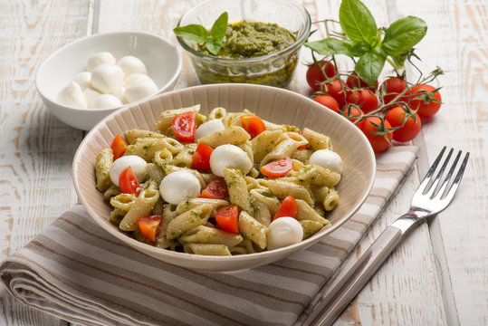 cold pasta salad with mozzarella and pesto sauce