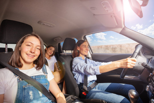Mother and two teenage daughters during road trip