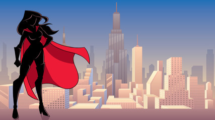 Silhouette superheroine standing tall against city background. Fotomurales