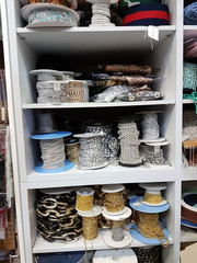Many rolls of chains and other products to decorate or make crafts in a haberdashery