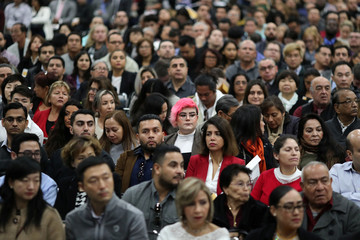 Immigrants participate in a naturalization ceremony to become U.S. citizens in Los Angeles