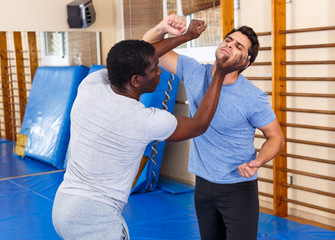 Two men practicing self defense techniques