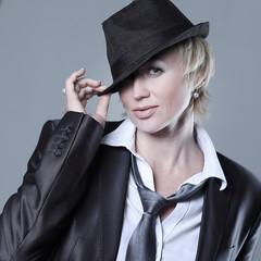 portrait of a scandalous woman in a black hat