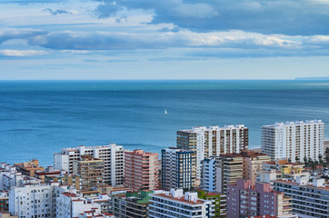 Aerial view of Cullera beach with village skyline in the Mediterranean Valencia of Spain