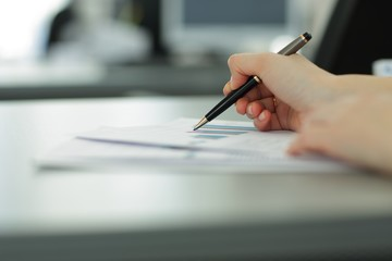 close up. blurred image of a business woman at her Desk