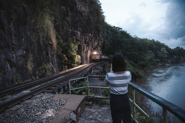 Happy young cute asian Japanese girl hipster backpack photography women taking a photo  at beautiful sky mountains scenery views