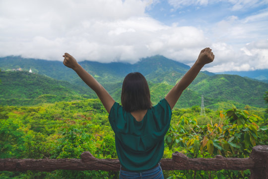 Happy young cute asian Japanese girl hipster backpack  women travelling looking at beautiful sky mountains scenery views