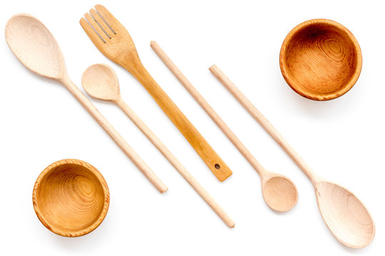 Village table with wooden cutlery set white background top view