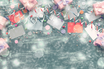 Festive grey background decoration for holiday colored confetti serpentine paper gifts box The view from the top was lying flat copyspace