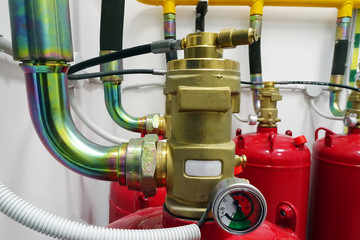 Gas cylinders of a fire extinguishing system.