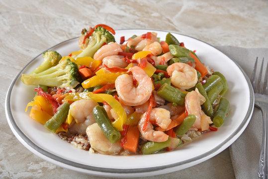 Gourmet shrimp stir fry on quinoa and rice
