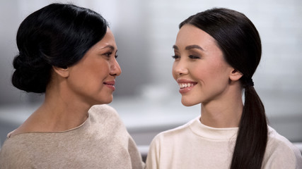 Beautiful asian woman looking at each other, mother and daughter spending time