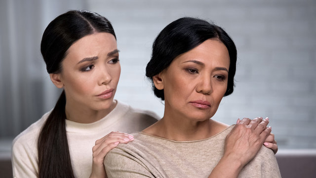 Caring daughter worrying about her mother, supporting ill family member, support
