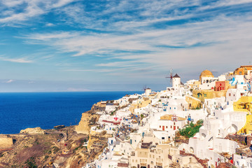 Architecture of Oia village, Santorini island in Greece, on a summer day. Scenic travel background.