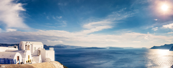 Fototapete - Panorama view of Santorini island in Greece, on a sunny day with beautiful sky. Scenic travel background.