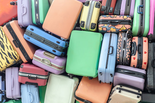 Close up of pile of old travel suitcases luggages stacked
