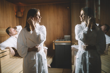 People enjoying sauna health benefits in spa