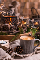 Fresh aromatic coffee and Christmas decor. Cozy festive atmosphere with candles and drinks. Free space for text.