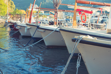 Traditional wooden boats in the harbor at mediterranean city marina port.