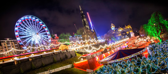 Wide panoramic view of Edinburgh's Christmas market, rotated photo